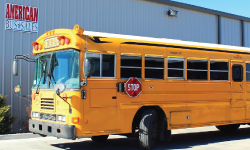 side profile of front of yellow school bus